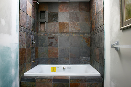 remodel tub shower units. This is a new jacuzzi shower combo with slate tile  No grout yet Nate s not going to do that step until the entire bathroom floor tiled Project Guy and master bath remodel thecreativejunkie com